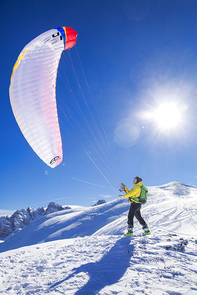 Paraglider, man preparing glider for takeoff, Axamer Lizum, Innsbruck, Tyrol, Austria, Europe