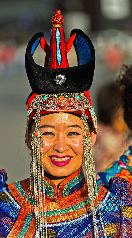 Young woman in traditional Deel clothes and hat with the typical conical tip, Festival of the Mongolian national costume, Ulaanbaatar, Mongolia, Asia