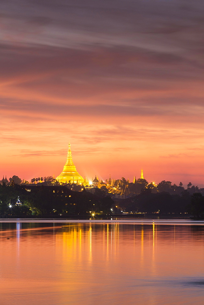 Illuminated Shwedagon Pagoda at sunset, The Great Dagon Pagoda, seen from Kandawgyi Lake, Yangon, Myanmar, Asia
