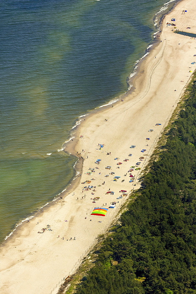 Bathers, sandy beach on the Baltic Sea, in the seaside resort Niechorze, Baltic Coast, West Pomerania Province, Poland, Europe