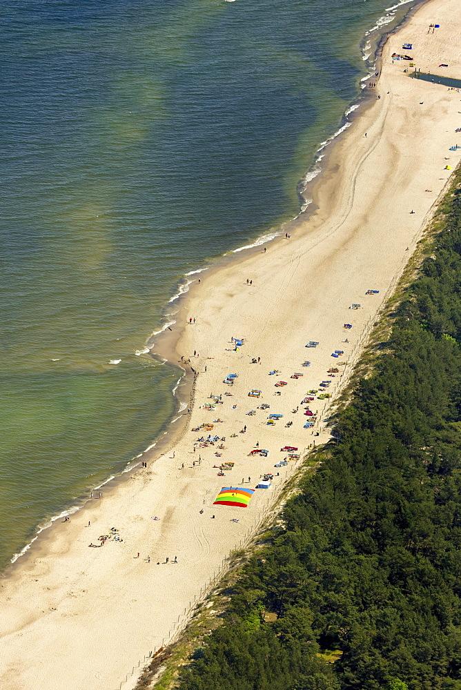 Bathers, sandy beach on the Baltic Sea, in the seaside resort Niechorze, Baltic Coast, West Pomerania Province, Poland, Europe