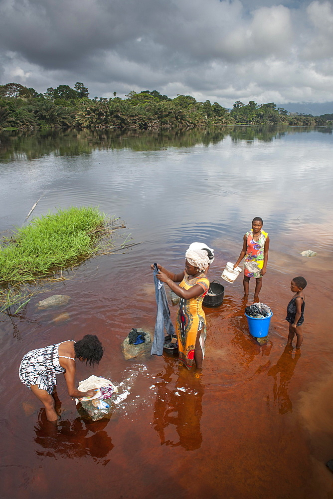 Women washing clothes in the river Ntem, in the rainforest, Campo, Southern Region, Cameroon, Africa
