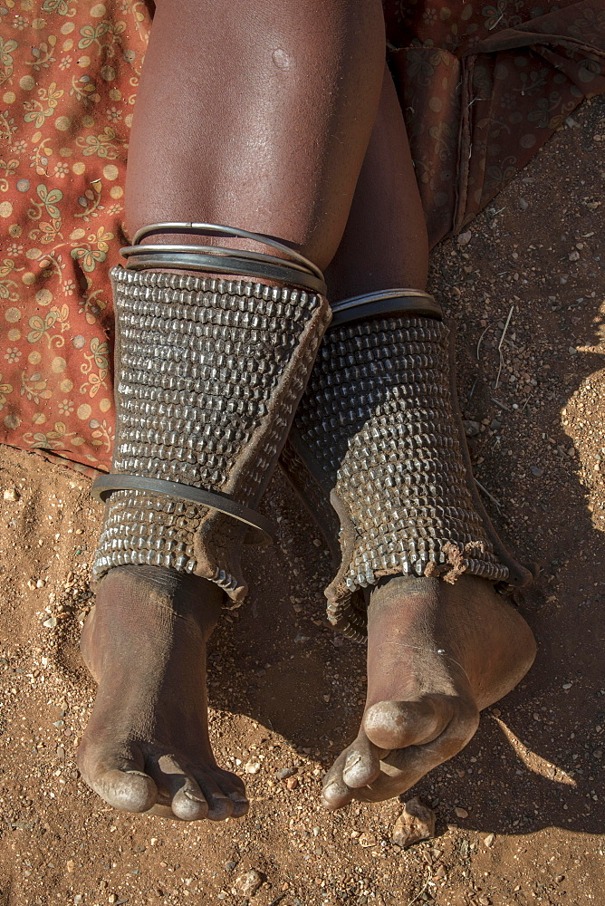 Leg ornamentation and at the same time protection against snake bites in the people of Ovahimba or Himba, Kunene district, Namibia, Africa