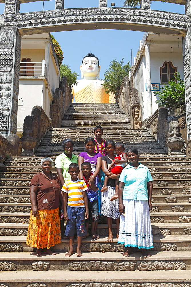 Women and children on the stairs to the Great Buddha, Kande Vihara Temple, Beruwela, Western Province, Ceylon, Sri Lanka, Asia