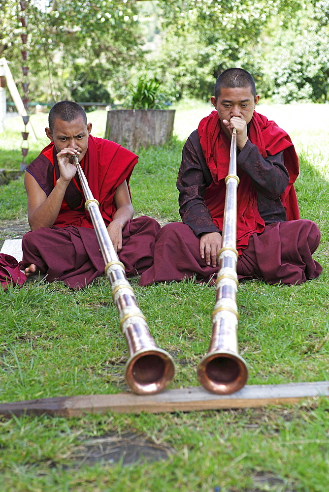 Monks playing tibetan horns, Chimi Temple, Punakha District, Bhutan, Asia