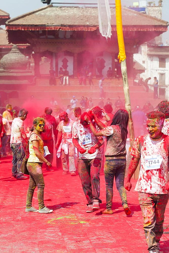 The colour run, part of the Holi festival celebrations, Kathmandu, Nepal, Asia