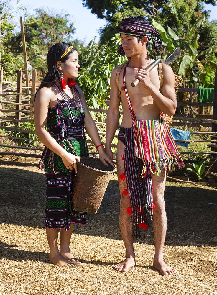 Phnong woman and man in traditional costume, ethnic minority, Pnong, Bunong, Senmonorom, Sen Monorom, Mondulkiri Province, Cambodia, Asia