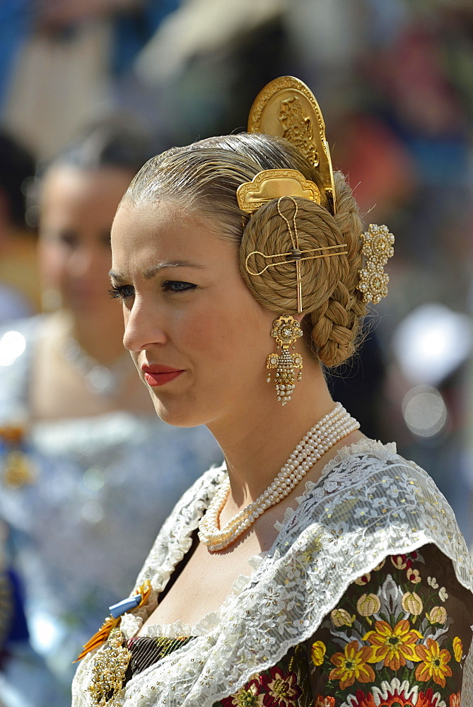 Fallas festival, woman in a traditional costume during the parade in the Plaza de la Virgen de los Desamparados, Valencia, Spain, Europe