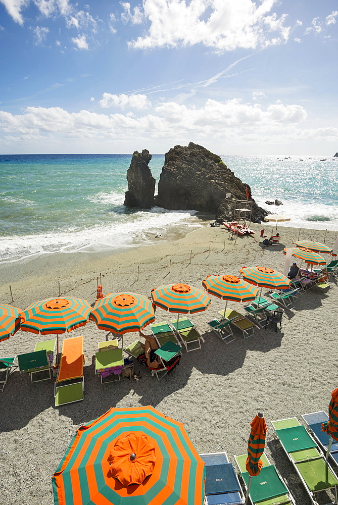 Sandy beach and colorful sunshades, Monterosso al Mare, Cinque Terre, La Spezia Province, Liguria, Italy, Europe