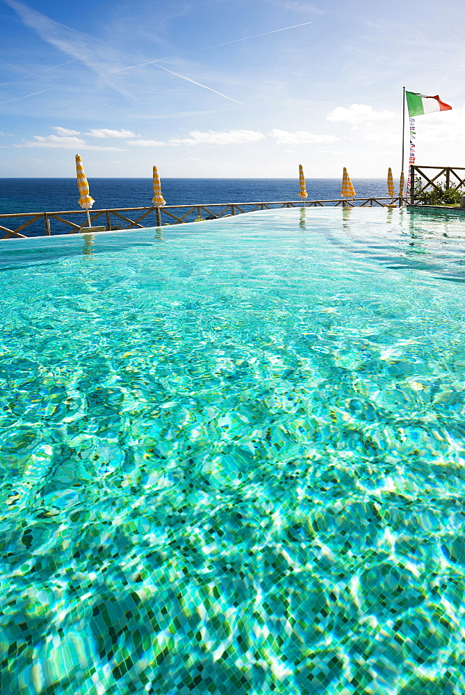 Swimming pool and the Mediterranean with the flag of Italy, Monterosso al Mare, Cinque Terre, La Spezia Province, Liguria, Italy, Europe