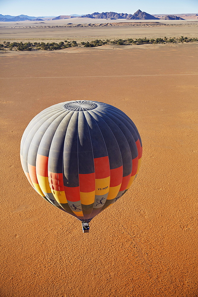 Hot air balloon, behind the Naukluft Mountains, Namib-Naukluft National Park, Namib Desert, Namibia, Africa