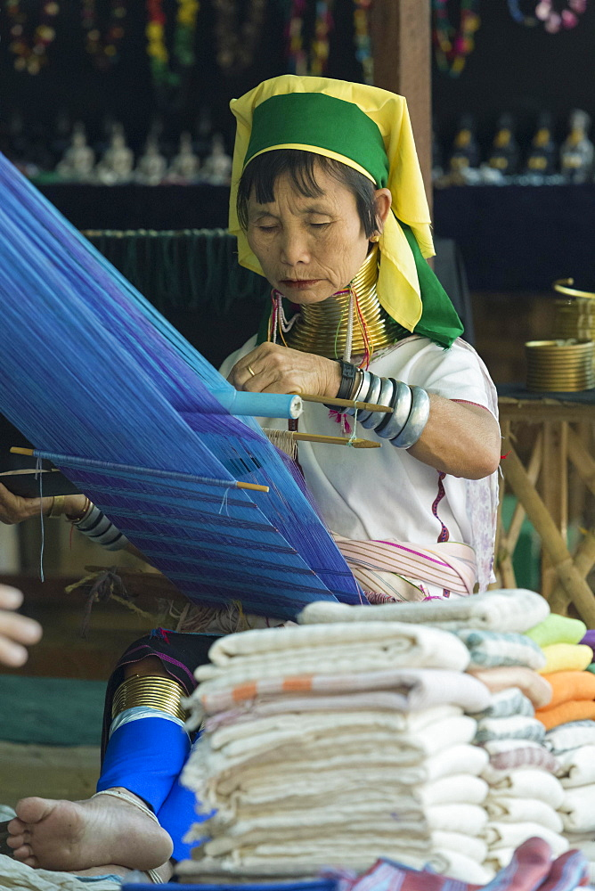 Padaung or long neck woman weaving, Inle lake, Myanmar, Asia