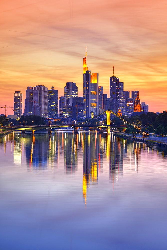 Skyline at dusk, TaunusTurm, Tower 185, Commerzbank, Messeturm, ECB, European Central Bank, Helaba, Landesbank Hessen, Deutsche Bank, Frankfurt Cathedral, Flosserbrucke bridge, Frankfurt am Main, Hesse, Germany, Europe