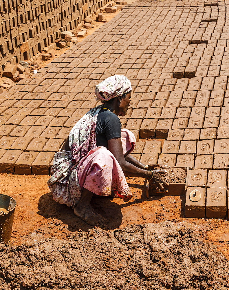 Indian woman producing adobe bricks, Usilampatti, Tamil Nadu, India, Asia