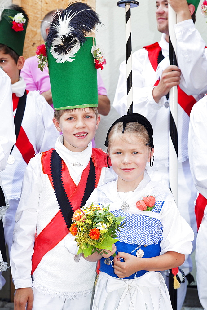 Boy and girl dressed in costume during the parade, Fischerstechen or water jousting festival, Ulm, Baden-Wurttemberg, Germany, Europe - 832-383415