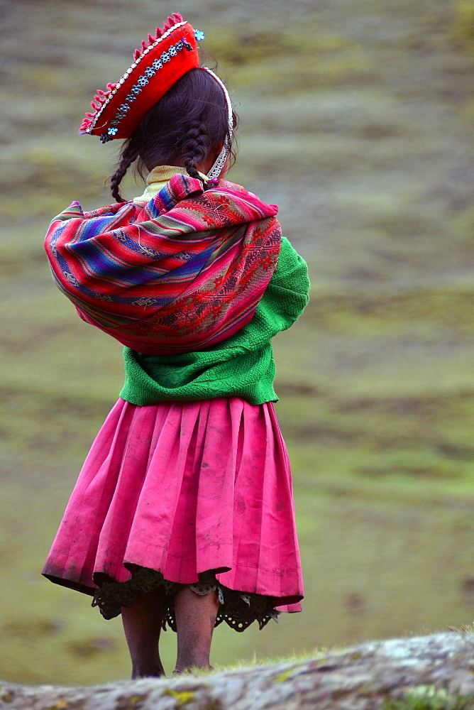 Girl wearing traditional costume, rear view, Andes, near Cusco, Peru, South America