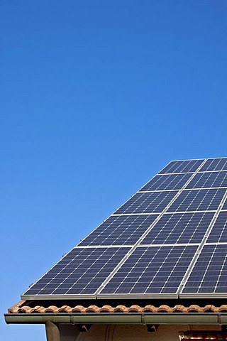Solar panels on a house roof, photovoltaic