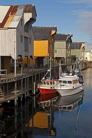 The colorful houses and boats of Nyksund on the Norwegian Sea on the island of Langoya, Langoya, part of the VesterÂlen, Vesteralen archipelago, Nordland, Norway, Europe
