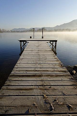 Lake Kochel with morning fog near Schlehdorf, Pfaffenwinkel, Upper Bavaria, Bavaria, Germany, Europe