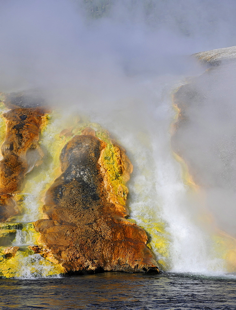 Outlet of the Excelsior Geyser in Firehole River, Midway Geyser Basin, colourful thermophilic bacteria, microorganisms, geysers, hot springs, Yellowstone National Park, Wyoming, United States of America, USA