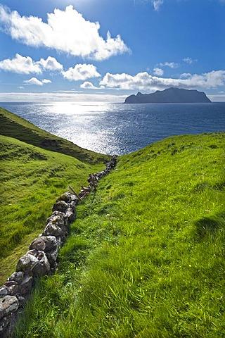 Old stone walls, view towards Mykines Island, Gasadalur, Vagar, Faroe Islands, Denmark, North Atlantic