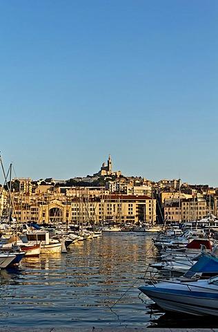 The Old Harbour, Vieux Port, with Basilica Notre Dame de la Garde in the distance, Marseille, Marseilles, Provence-Alpes-Cote d'Azur, France, Europe