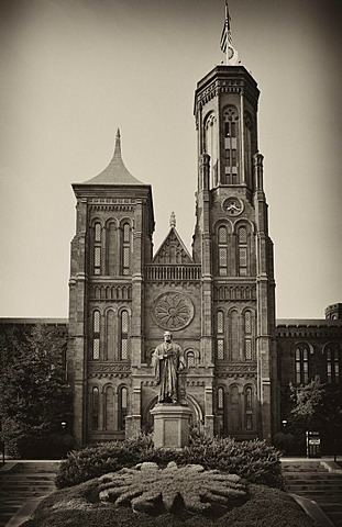 "Black and white image, sepia, statue of the scientist Joseph Henry in front of the Smithsonian Institution Building, admin building and museum, commonly known as ""The Castle"", National Mall, Washington DC, District of Columbia, United States of America, P"