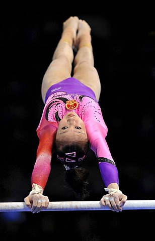 Qiushuang Huang, CHN, performing on uneven bars, EnBW Gymnastics World Cup, 11 to 13 Nov 2011, 29th DTB Cup, Porsche-Arena, Stuttgart, Baden-Wuerttemberg, Germany, Europe