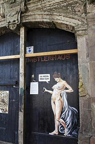 Female nude holding an iPhone, graffito on a decrepit house, an artists' centre in Weimar, Thuringia, Germany, Europe