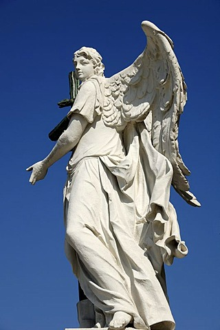 Sculpture of an angel with a cross in front of Karlskirche, St. Charles Church, Roman Baroque, completed in 1737, Karlsplatz Square, Vienna, Austria, Europe