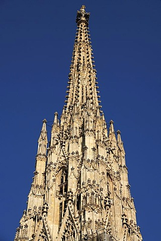 Gothic spire of Stephansdom, St. Stephen's Cathedral, against blue sky, Stephansplatz, Vienna, Austria, Europe