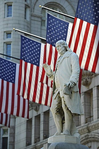 Benjamin Franklin statue in front of the Nancy Hanks Center, NEA, former Old Post Office Pavilion, US flags, Washington DC, District of Columbia, United States of America, PublicGround