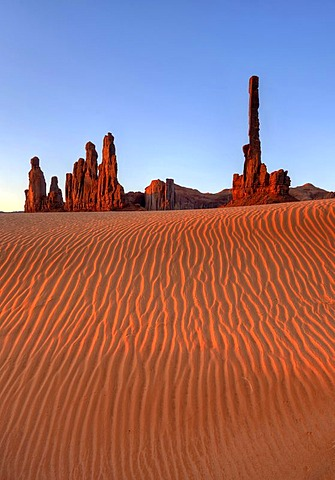 Sand dunes in front of Totem Pole and Yei Bi Chei rock formation, Monument Valley, Navajo Tribal Park, Navajo Nation Reservation, Arizona, Utah, United States of America, USA
