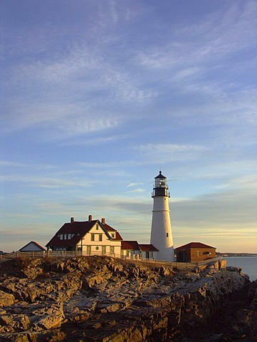 Portland Head Lighthouse illuminated by warm morning light, Cape Elizabeth, Maine, USA
