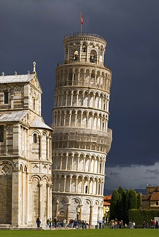 The Leaning Tower of Pisa against dark clouds, Tuscany, Italy, Europe