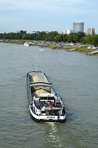 Freight ship transporting sand near Duesseldorf, Sky Office Building, navigation on the Rhine River, Duesseldorf, North Rhine-Westphalia, Germany, Europe