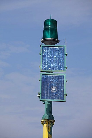 A green lamp and solar panels on a pole, navigation light, aids to navigation, Mi&dzyzdroje beach resort, Misdroy, Wolin Island, Baltic Sea, West Pomeranian Voivodeship, Poland, Europe