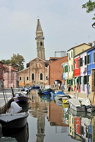 Colourfully painted houses, leaning church tower, boats on the canal, Burano, an island in the Venetian Lagoon, Italy, Europe