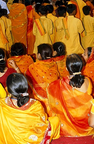 A group of women joining the Aartii Ceremony at Ram Jhula in Rishikesh, Uttarakhand, formerly Uttaranchal, India, Asia