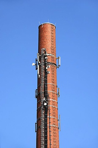 Transmission facilities on the old chimney of a dilapidated brick factory against the blue sky, Spardorf, Middle Franconia, Bavaria, Germany, Europe