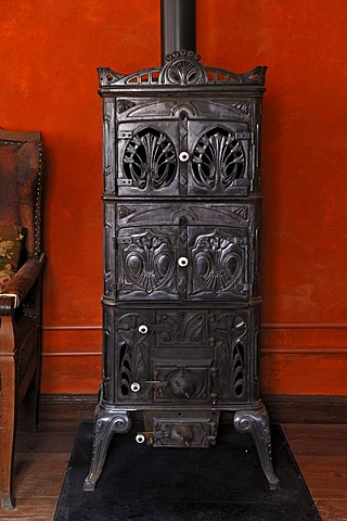 Cast iron stove, circa 1900, living room in the teacher's apartment, school building from Pfaffenhofen, built in 1801, Franconian open-air museum, Eisweiherweg 1, Bad Windsheim, Middle Franconia, Bavaria, Germany, Europe
