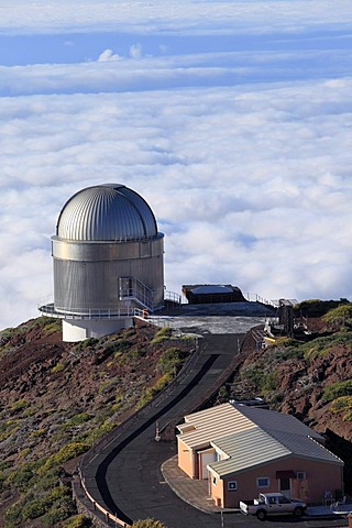 View over the cloud cover with Nordic Optical Telescope observatory, astronomical telescope, Roque de los Muchachos Observatory or Observatorio del Roque de los Muchachos or ORM, Mt. Roque de los Muchachos, volcanic island of La Palma, La Isla Verde, La I