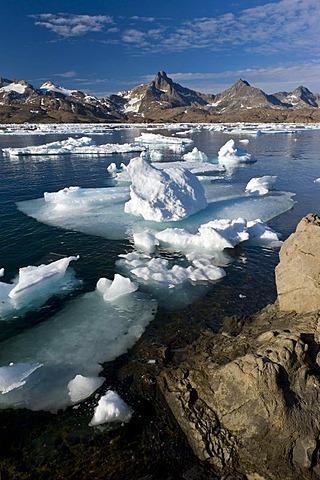 Floating ice sheets and mountains, Tasiilaq or Ammassalik, East Greenland, Greenland