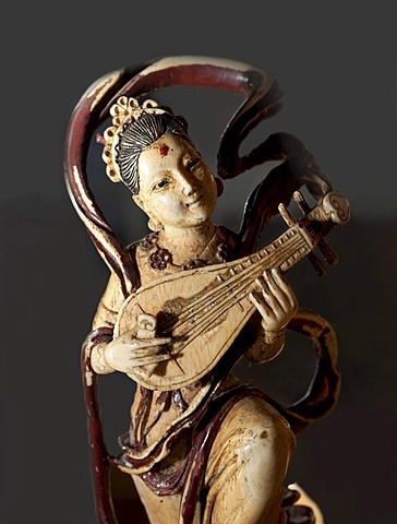 Carved ivory figurine, woman playing a pipa, a traditional Chinese lute, East Asia exhibition at the Haus Kemnade moated castle, Hattingen, North Rhine-Westphalia, Germany, Europe