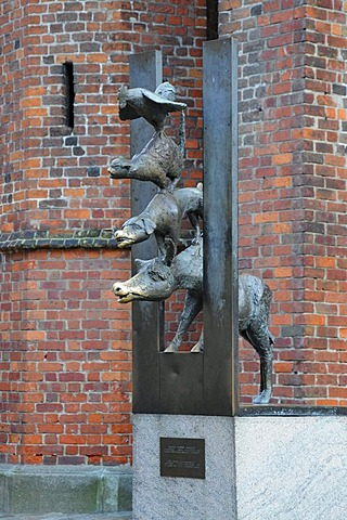 Statue of the Town Musicians of Bremen beside St. Peter's Church, Riga, historic town centre, Latvia, Baltic States, Northern Europe