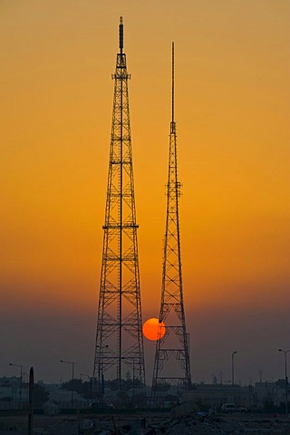 Giant electricity pylon in front of a setting sun, Doha, Qatar, Arabian Peninsula, Middle East