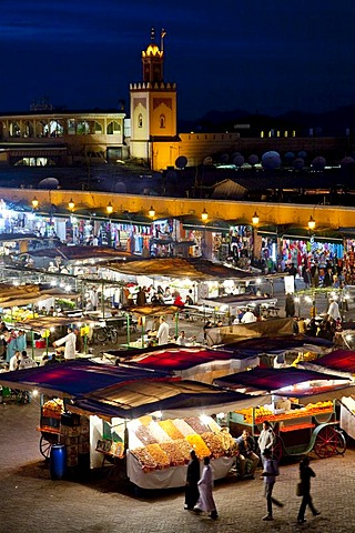 Food and market stalls in Djemaa El Fna square at night, medina or old town, UNESCO World Heritage Site, Marrakech, Morocco, Africa