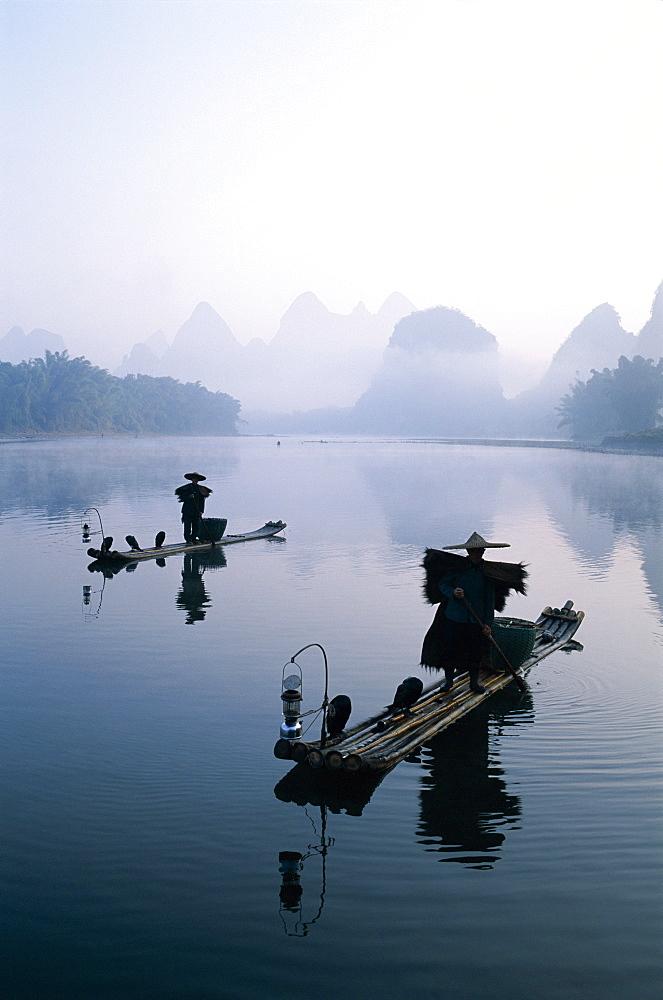 Cormorant fishermen at dawn on the Li River, Guilin, Yangshou, Guangxi Province, China, Asia