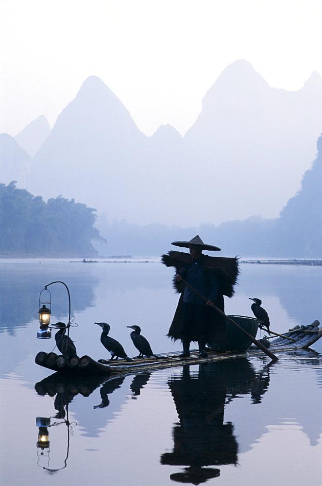 Cormorant fisherman at dawn on the Li River, Guilin, Yangshou, Guangxi Province, China, Asia - 834-1092