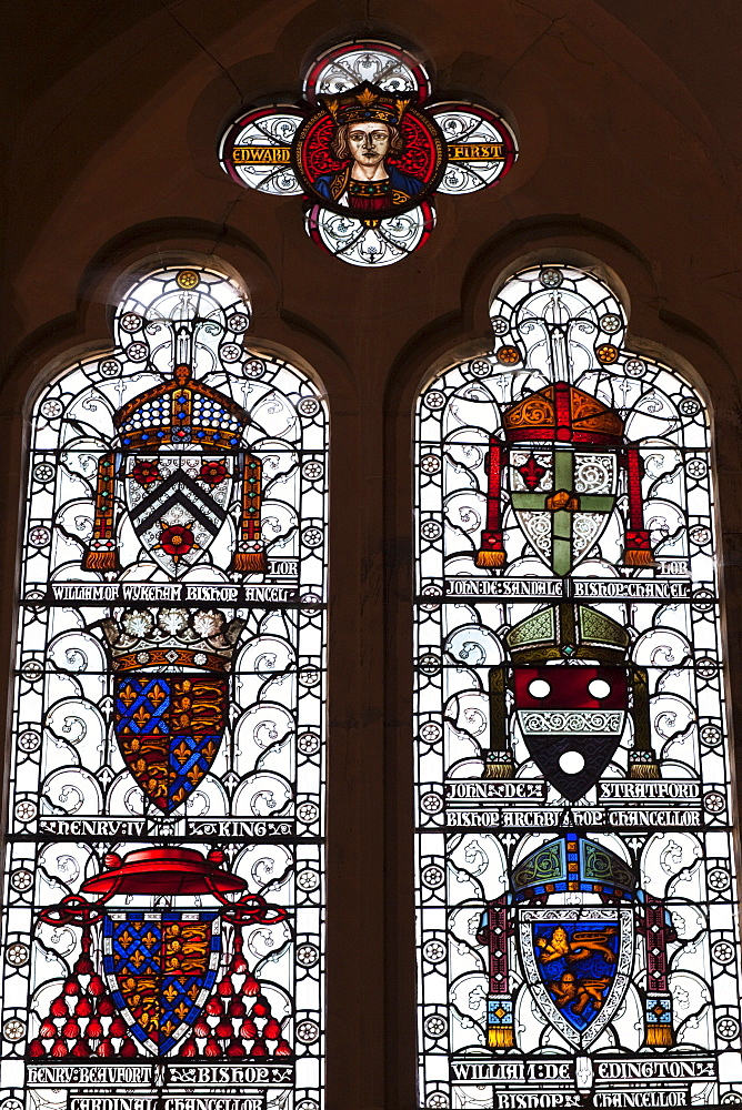 Stained glass window depicting coats of arms, The Great Hall, Winchester, Hampshire, England, United Kingdom, Europe